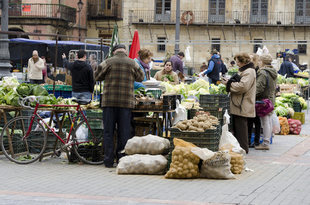 social grace: LEON, SPAIN - JANUARY 30, 2013: Popular market of fruits and vegetables in the main square, on January 30, 2013 in Leon, Spain