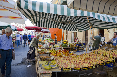 palermo   italy: PALERMO, SICILY, ITALY - OCTOBER 3, 2012: Buyers and sellers in a street market of fruits and vegetables, on October 3, 2012 in Palermo, Italy