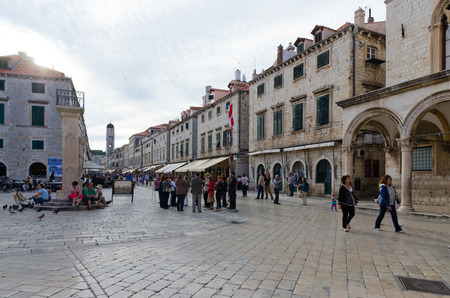 walking zone: DUBROVNIK, CROATIA - MAY 15, 2013: People walking down the main street in the old town of Dubrovnik at night. Pedestrian zone in an old, European town. On 15 May 2013 in Dubrovnik, Croatia