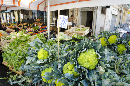 palermo   italy: PALERMO, SICILY, ITALY - OCTOBER 3, 2012: A greengrocer street, it is packed with cauliflower, on October 3, 2012 in Palermo, Italy Editorial