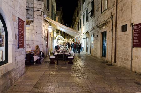 walking zone: DUBROVNIK, CROATIA - MAY 16, 2013: People walking down the main street in the old town of Dubrovnik at night. Pedestrian zone in an old, European town. On 16 May 2013 in Durbrovnik, Croatia