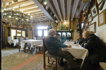 segovia: SEGOVIA, SPAIN - MARCH 3, 2013: People in a restaurant in Segovia. With the nearby Madrid, Segovia is a popular destination for small-scale tourism. Editorial