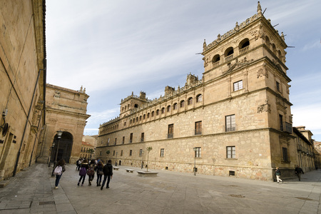 exponents: SALAMANCA, SPAIN - FEBRUARY 5, 2013: Group of young students beside the Palacio de Monterrey, Monterrey Palace in Salamanca (Spain) is one of the greatest exponents of the art style plateresco in Spain. Built by the third Earl of Monterrey, now owned by t