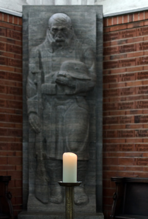 st german: LUBECK, GERMANY-SEPTEMBER 26: Statue in memory and tribute to the fallen German soldiers in the First World War in St Jakobs Church, Lubeck on September 26, 2013. Editorial