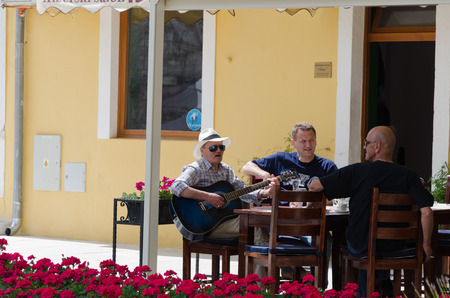trio: ZADAR, CROATIA - MAY 21, 2013: A joyful threesome sat on the terrace of a cafe street in Zadar, Croatia. On May 21, 2013, in Zadar, Croatia Editorial