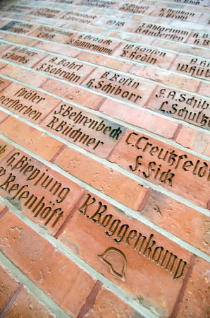 st german: LUBECK, GERMANY-SEPTEMBER 26: Names of German soldiers killed in World War I written to a wall in St Jakobs Church, Lubeck on September 26, 2013.