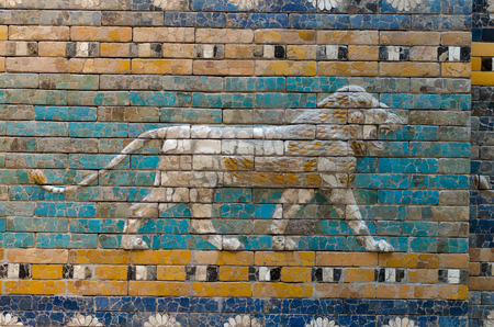 babylonian: BERLIN, GERMANY - SEPTEMBER 28, 2013: Detailed depiction of the symbolic Babylonian animal - the lion - at the reconstructed Ishtar Gate and Processional Way in the Pergamon Museum on the Berlin museum island.