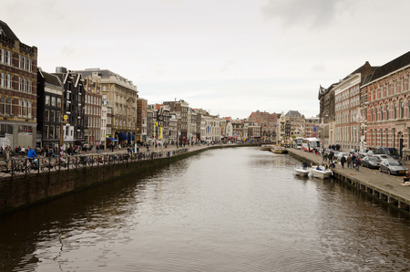 gabled: AMSTERDAM - OCTOBER 20, 2013:  Canal in Amsterdam on October 20, 2013. Amsterdam has been called the Venice of the North for its more than 100 kilometers of canals, about 90 islands and 1,500 bridges. Editorial