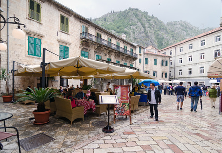 kotor: KOTOR, MONTENEGRO - MAY 17, 2013: Old Kotor City in Montenegro, Europe as the people are enjoy at the cafe. On May 17, 2013 in Kotor, Montenegro