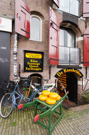gimmick: AMSTERDAM - OCTOBER 20, 2013: Publicity gimmick at the door of a shop that sells the traditional Dutch cheese, on October 20, 2013