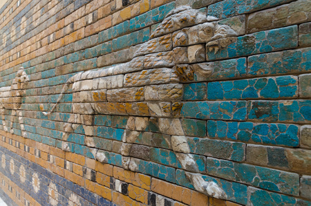 ishtar: BERLIN, GERMANY - SEPTEMBER 28, 2013: Detailed depiction of the symbolic Babylonian animal - the lion - at the reconstructed Ishtar Gate and Processional Way in the Pergamon Museum on the Berlin museum island.