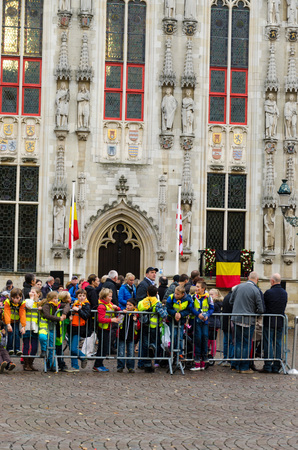 acclaim: BRUGES, BELGIUM - OCTOBER, 25: People wait in the streets to welcome the King Philippe of Belgium, on October25, 2013, in Bruges, Belgium. King Albert II announced on 3 July 2013 that he would abdicate in favour of Philippe Editorial