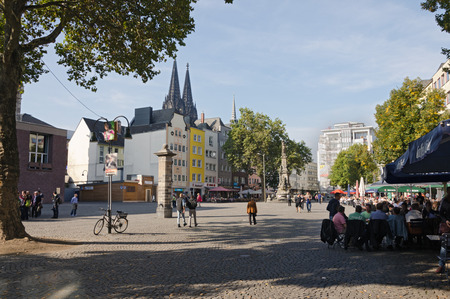 tourist spots: COLOGNE, GERMANY - SEPTEMBER 24: People on a street with bars and restaurants in September 24, 2013 in Cologne, Germany. Cologne is a popular tourist spots in the world.