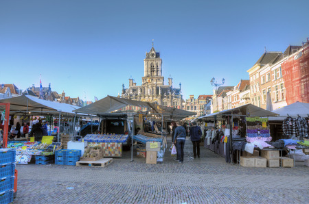 dutch culture: DELFT, NETHERLANDS - OCTOBER 24: People in the traditional market on the main square, on October 24, 2013 in Delft, Netherlands Editorial