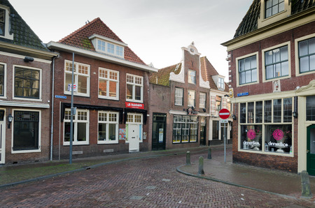 dutch typical: HOORN, THE NETHERLANDS - OCTOBER 22: Typical Dutch architecture on October 22, 2013 in Hoorn, The Netherlands Editorial