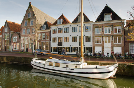 hoorn: HOORN, THE NETHERLANDS - OCTOBER 22: Sailing ship at anchor in a navigable channel on October 22, 2013 in Hoorn, The Netherlands