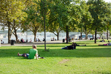 tourist spots: COLOGNE, GERMANY - SEPTEMBER 24: Young enjoying a public park on a sunny afternoon in September 24, 2013 in Cologne, Germany. Cologne is a popular tourist spots in the world. Editorial