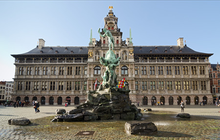 tent city: ANTWERP, BELGIUM - OCTOBER 26: The statue of the Throwing of the Giant Hand in front of City Hall on October 26, 2013 in  in Antwerp, Belgium. City Hall sits in the Main Square or Grote Market of Antwerp. Editorial