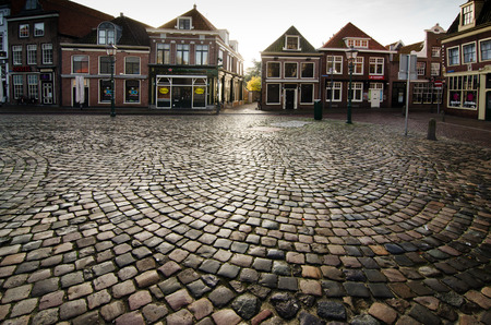 hoorn: HOORN, THE NETHERLANDS - OCTOBER 22: Cobblestone pavement on a Dutch street,  on October 22, 2013 in Hoorn, The Netherlands
