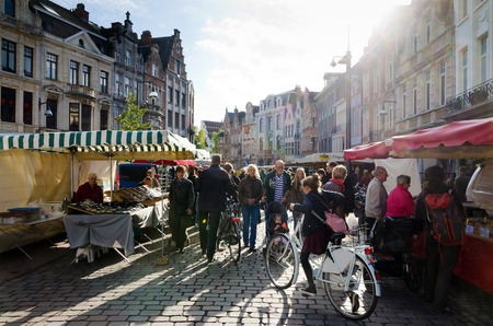 lier: LIER,  BELGIUM - OCTOBER, 26: Unidentified people on the street market, on October 26, 2013, in Lier, Belgium. Lier is a municipality located in the Belgian province of Antwerp.