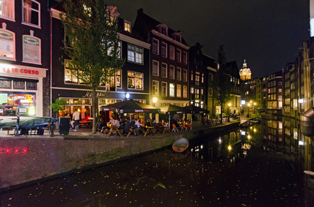 brothel: AMSTERDAM - OCTOBER 22, 2013: Red-light district in Amsterdam on October 22, 2013 in Amsterdam, Netherlands. There are about three hundred cabins rented by prostitutes in the area.