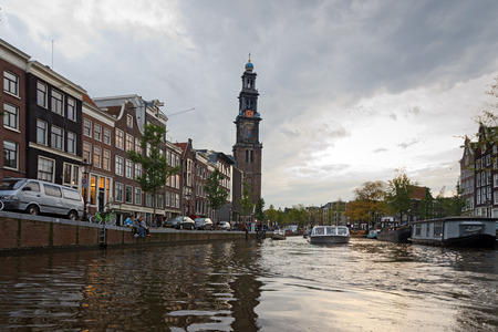 kilometres: AMSTERDAM - OCTOBER 22, 2013: Canals on October 22, 2013 in Amsterdam. Amsterdam, capital of the Netherlands has more than one hundred kilometres of canals, about 90 islands and 1,500 bridges.