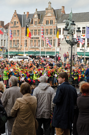 favour: BRUGES, BELGIUM - OCTOBER, 25: People wait in the streets to welcome the King Philippe of Belgium, on October25, 2013, in Bruges, Belgium. King Albert II announced on 3 July 2013 that he would abdicate in favour of Philippe Editorial