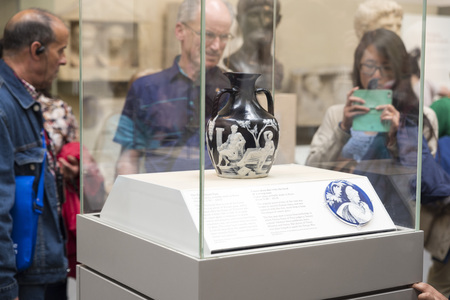best ad: LONDON, UNITED KINGDOM - JUNE 5, 2014: British Museum. Visitors look at the Portland Vase is a Roman cameo glass vase, which is dated to between AD 1 and AD 25, though low BC dates have some scholarly support. It is the best known piece of Roman cameo gla