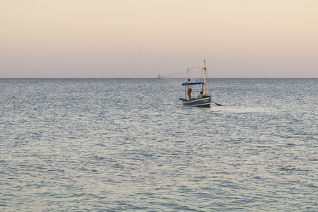 net fishing: TRINIDAD, CUBA - MAY 8, 2014: Two Persons. Cuban Fishermans Net Fishing With Rowboats in Playa Ancon, near Trinidad, Cuba.