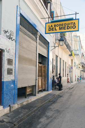 HAVANA -MAY 5: La Bodeguita del Medio on May 5, 2014 in Havana. Since its opening in 1942, this bar has been a favorite of Ernest Hemingway and Pablo Neruda among other personalities. Editorial