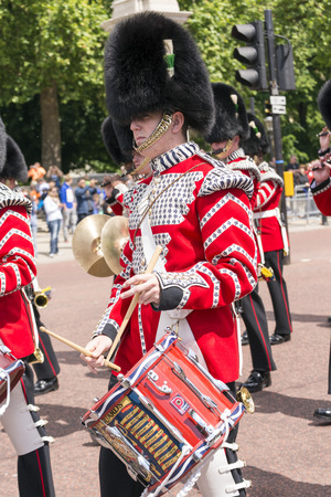 wedding parade: LONDON, UNITED KINGDOM - JUNE 5, 2014: British guardsmen march down the Mall in London - outside Buckingham Palace.