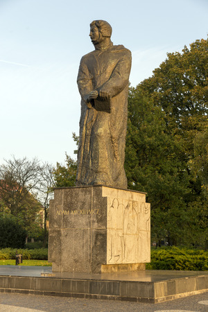 bard: POZNAN, POLAND - OCTOBER 24, 2014: monument, sculpture - bard Adam Mickiewicz Poznan, Poland