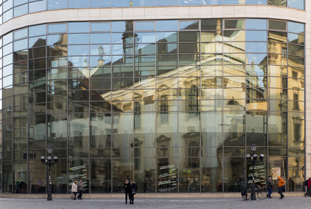 edifice: WROCLAW, POLAND - OCTOBER24, 2014: The main edifice of the Wroclaw University reflected by the glass of the building opposite