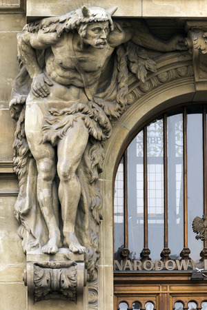 telamon: Gdansk, Polan - October, 22 2014: Sculpture of an Atlantean on the facade of a building Editorial