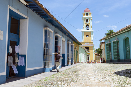 renewed: TRINIDAD, CUBA - MAY 8, 2014: Old town of Trinidad, Cuba. Trinidad is a historical town listed by UNESCO as World Heritage, it is full of colonial buildings and main tourist spot.