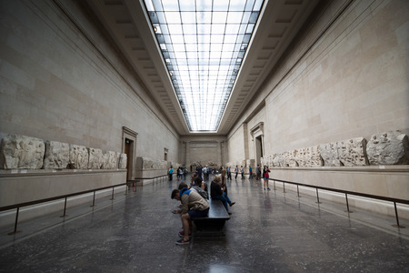 british museum: LONDON, UNITED KINGDOM - JUNE 5, 2014: British Museum. Visitors in the room where the sculptures from the Parthenon exposed