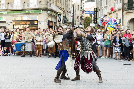 jousting: PONTEVEDRA, SPAIN - SEPTEMBER 5, 2014: Historical reenactment of a fight between medieval knights at the annual festival Feira Franca