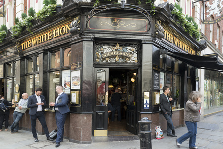 covent: LONDON, UNITED KINGDOM - JUNE 5,  2014: Customers outside The White Lion a popular pub near Covent Garden, London