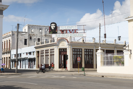 top 7: CIENFUEGOS, CUBA - MAY 7, 2009. A house with a Che Guevara sign on the top, in Cienfuegos, Cuba, on May 7, 2014