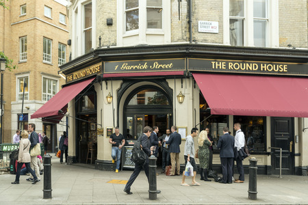 covent: LONDON, UNITED KINGDOM - JUNE 5,  2014: Customers outside The Round House a popular pub near Covent Garden, London