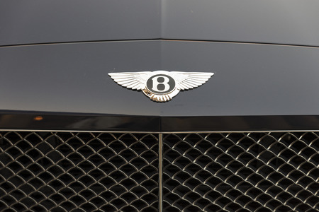 grille: LIVERPOOL, ENGLAND - JUNE 8, 20149: Marque and grille of a Bentley Continental GT. A British manufacturer of prestige automobiles, the company was founded by Walter Owen Bentley in 1919 and has been owned by the Volkswagon Group since 1998. The business i Editorial