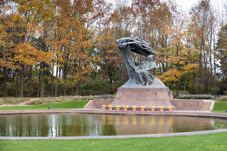 lazienki: Warsaw, Poland - October 20, 2014: Frederic Chopin Monument in Warsaw, Poland. Situated in the Lazienki park complex. Unveiled in 1926, destroyed during WWII, reconstructed in 1958. Editorial