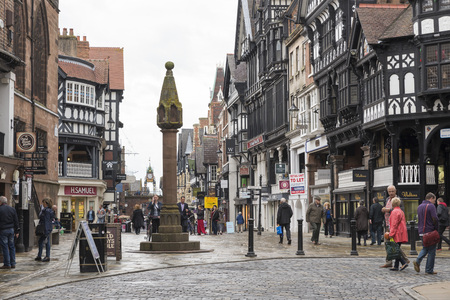 social history: CHESTER, UK - JUNE 9,2014: City centre shopping in the historic centre of Chester. The Cross marks the centre of the Roman city.