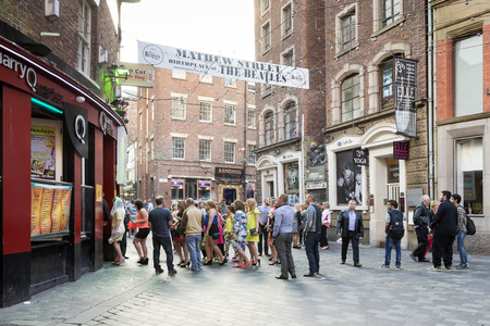 venues: LIVERPOOL, UNITED KINGDOM - JUNE 7, 2014: Saturday afternoon in Liverpool, people have fun in bars Mathew Street famous for being the home of The Cavern Club - one of the venues in which The Beatles began their career Editorial
