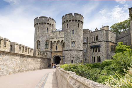 windsor: WINDSOR, UNITED KINGDOM - JUNE 6, 2014: Outside view of Medieval Windsor Castle  Windsor, England. Windsor Castle is a royal residence at Windsor in the English county of Berkshire.
