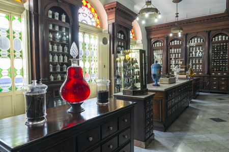 lozenge: MATANZAS, CUBA - MAY 10: This old French Colonial pharmacy, formerly known as Botica La Francesa, was founded by Dr Ernesto Triolet in 1882 and stands unchanged today in the city of Matanzas, Cuba. May 10, 2014