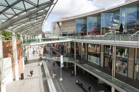 retail shopping: LIVERPOOL, UNITED KINGDOM - JUNE 10, 2014: People shopping in Liverpool One mall. Liverpool One is a shopping, residential and leisure complex in Liverpool, England, United Kingdom. Editorial