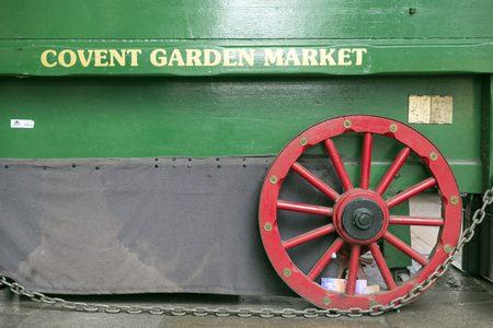 covent: LONDON, UNITED KINGDOM - JUNE 5,  2014: Peddler wagon has Covent Garden Market painted on the side, Apple Market, Covent Garden, London
