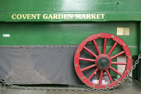 covent garden market: LONDON, UNITED KINGDOM - JUNE 5,  2014: Peddler wagon has Covent Garden Market painted on the side, Apple Market, Covent Garden, London