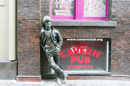 john lennon: LIVERPOOL, UK - JUNE 8, 2014: A statue of John Lennon situated at Mathew Street opposite the historic Cavern Club in Liverpool